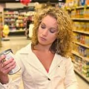 Woman reading can of dog food